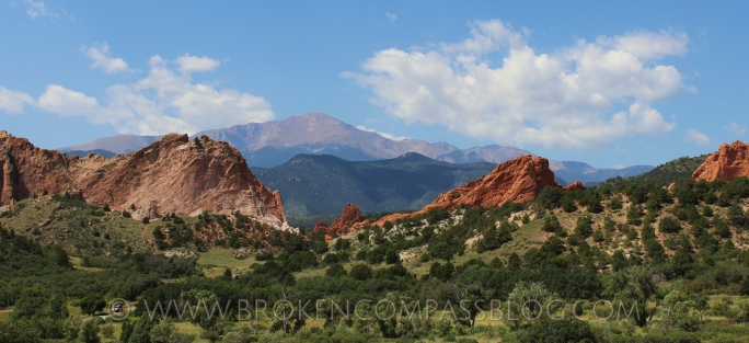 The Garden of the Gods are in the foreground framing Pike's Peak in the background.